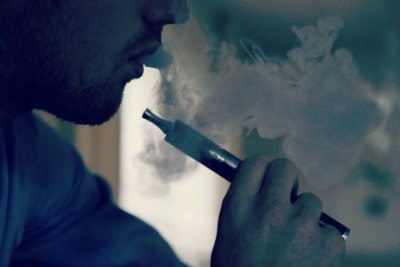 E-cigarette with vapor coming out