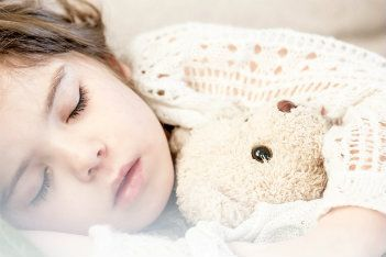 Sleeping child withteddy  bear